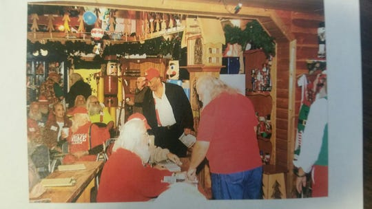 Jeryn Calhoun (center) attended the Charles W. Howard Santa Claus School in Midland, Michigan where he was certified as a professional Santa in 2008.