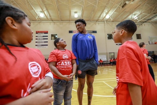 """Children with incarcerated parents from the Pure Heart Foundation joke around with Detroit Pistons forward Stanley Johnson asking him how tall he is at the Pistons practice facility in Auburn Hills during the event """"Very Merry Casey Christmas"""" on Saturday, Dec. 8, 2018."""