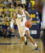 Michigan Wolverines guard Jordan Poole dribbles during the first half against the South Carolina Gamecocks, Saturday, Dec. 8, 2018 at the Crisler Center in Ann Arbor.