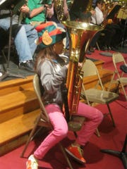 Tuba players of all ages and skill levels art part of Merry TubaChristmas.