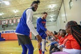 Pistons coach Dwane Casey invites children with incarcerated parents to practice, and players surprise them with gifts Saturday, Dec. 8, 2018.