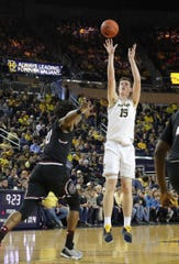 Jon Teske scores against South Carolina forward Chris Silva in the first half Saturday.