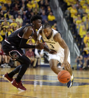 e6176aaae72 Michigan Wolverines guard Zavier Simpson drives against South Carolina  Gamecocks forward Keyshawn Bryant during the second