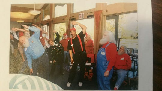 Jeryn Calhoun (center) doing some stretches at the Charles W. Howard Santa Claus School in Midland, Michigan where he was certified as a professional Santa in 2008.