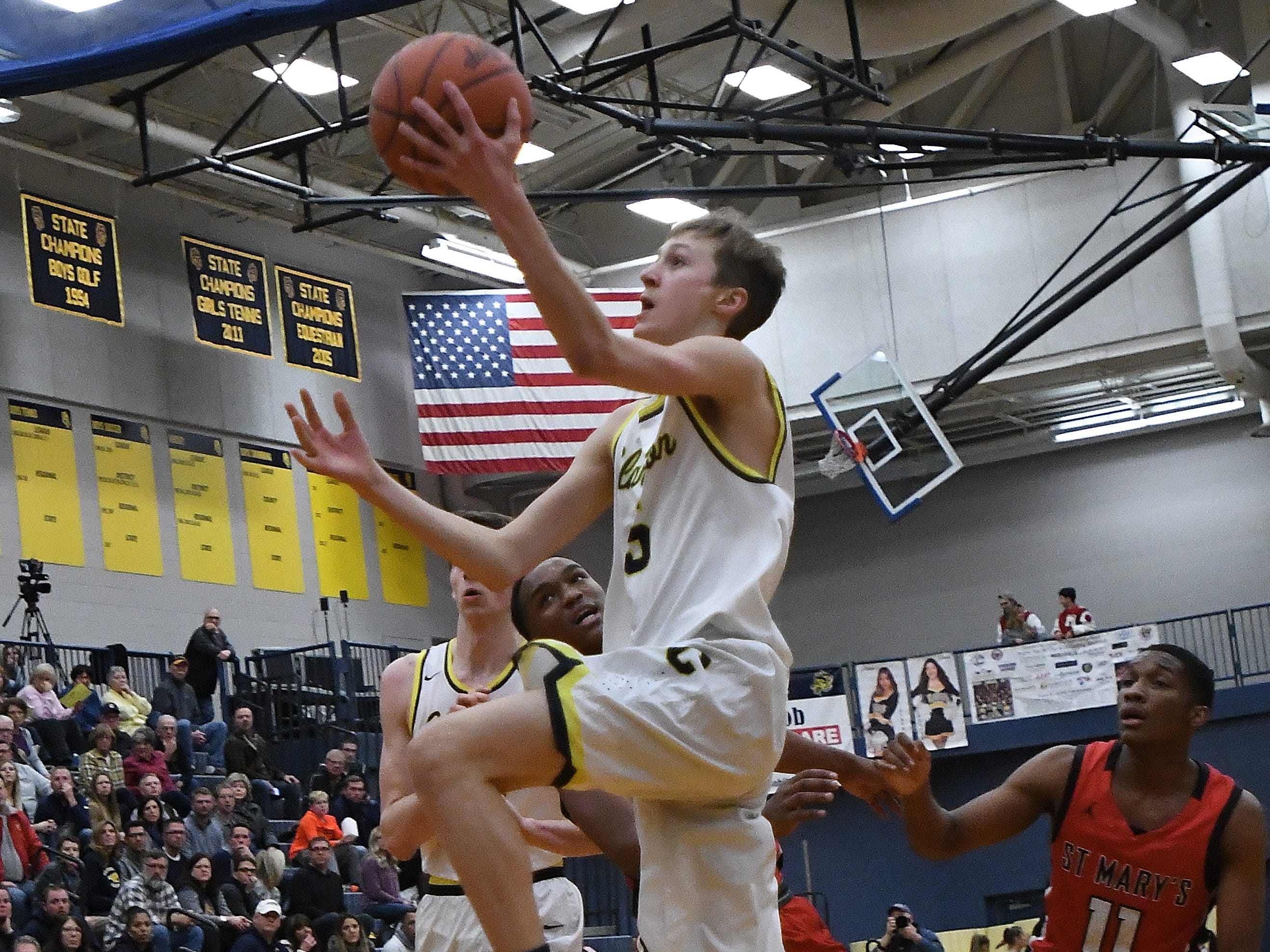 Clarkston's Fletcher Loyer climbs the ladder to the basket for two in the second quarter.