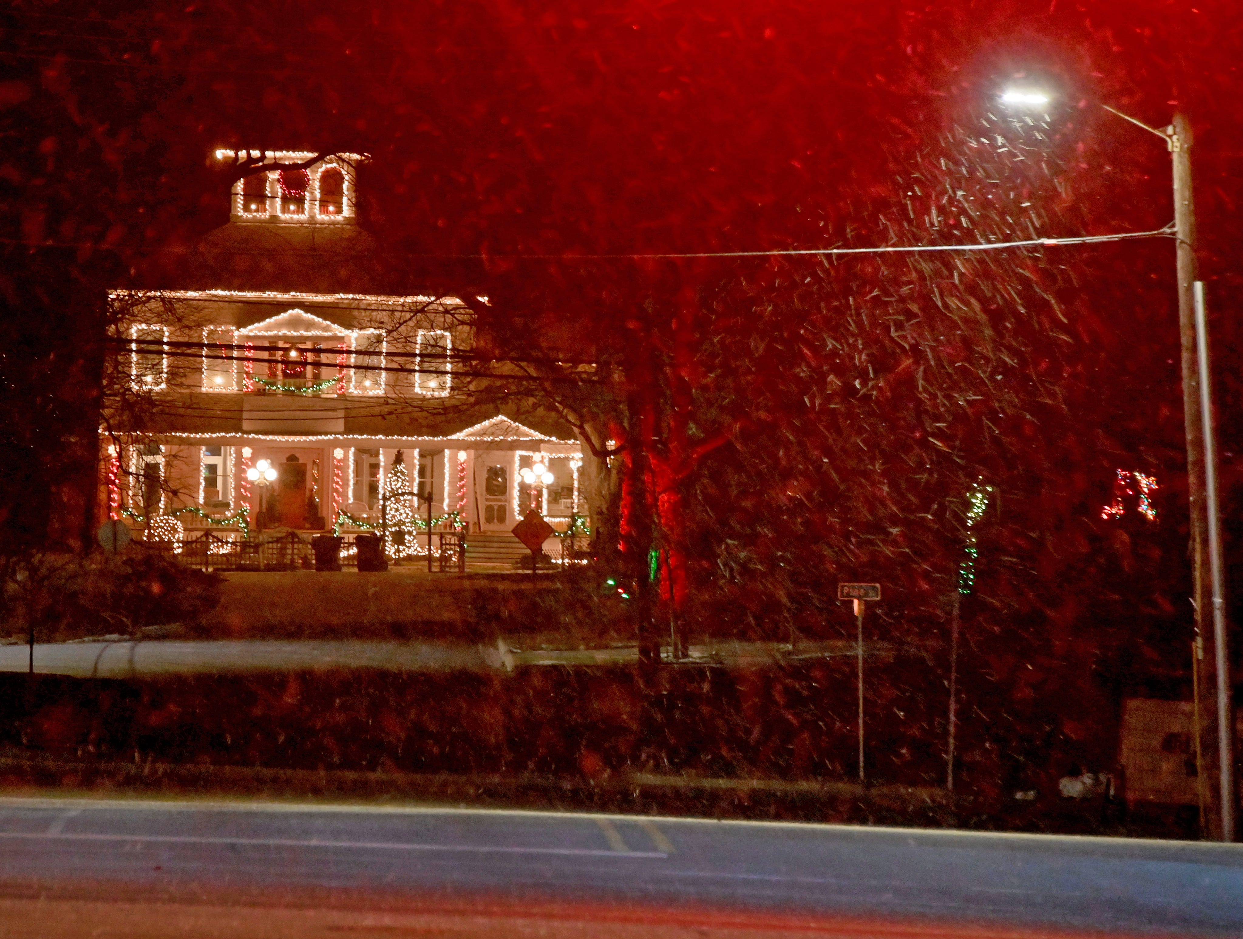 Nestled back from the highway at the end of a side street in Chesaning, Mi, this stately home glows with Christmas Lights.