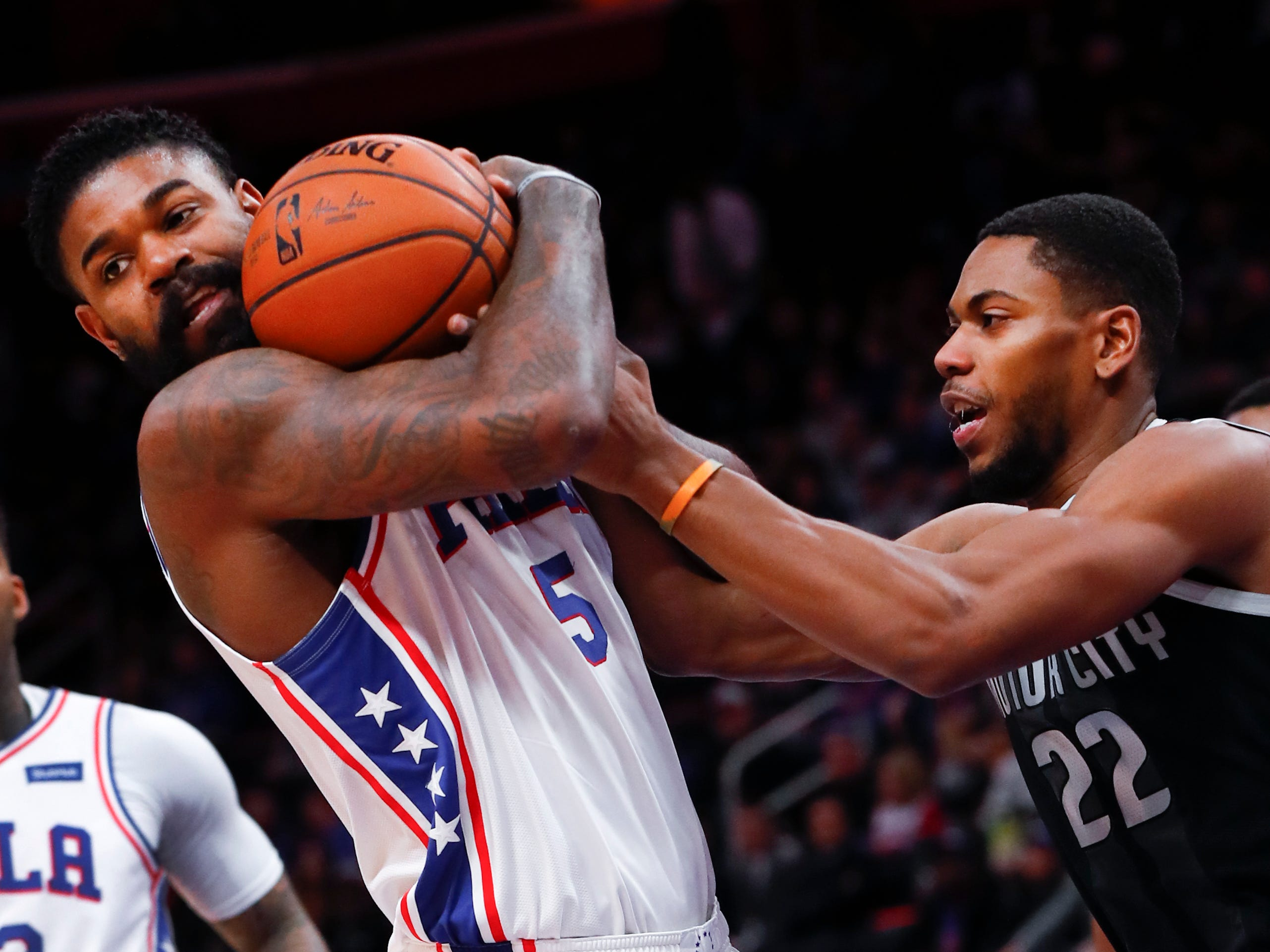 Philadelphia 76ers center Amir Johnson (5) and Detroit Pistons guard Glenn Robinson III (22) battle for the ball in the first half of their game in Detroit, Friday, Dec. 7, 2018.