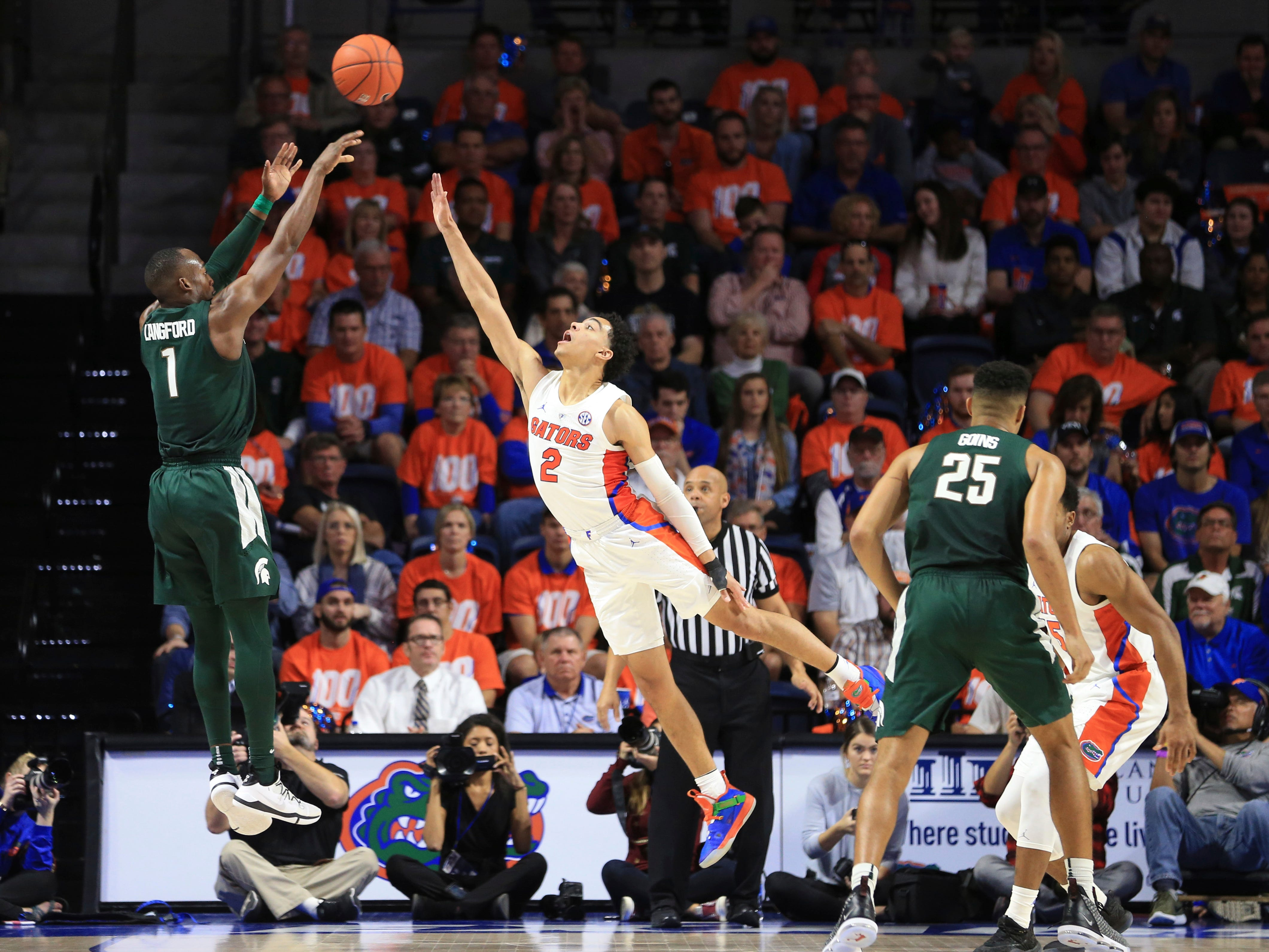 Michigan State guard Joshua Langford (1) makes a shot over Florida guard Andrew Nembhard (2) during the second half.
