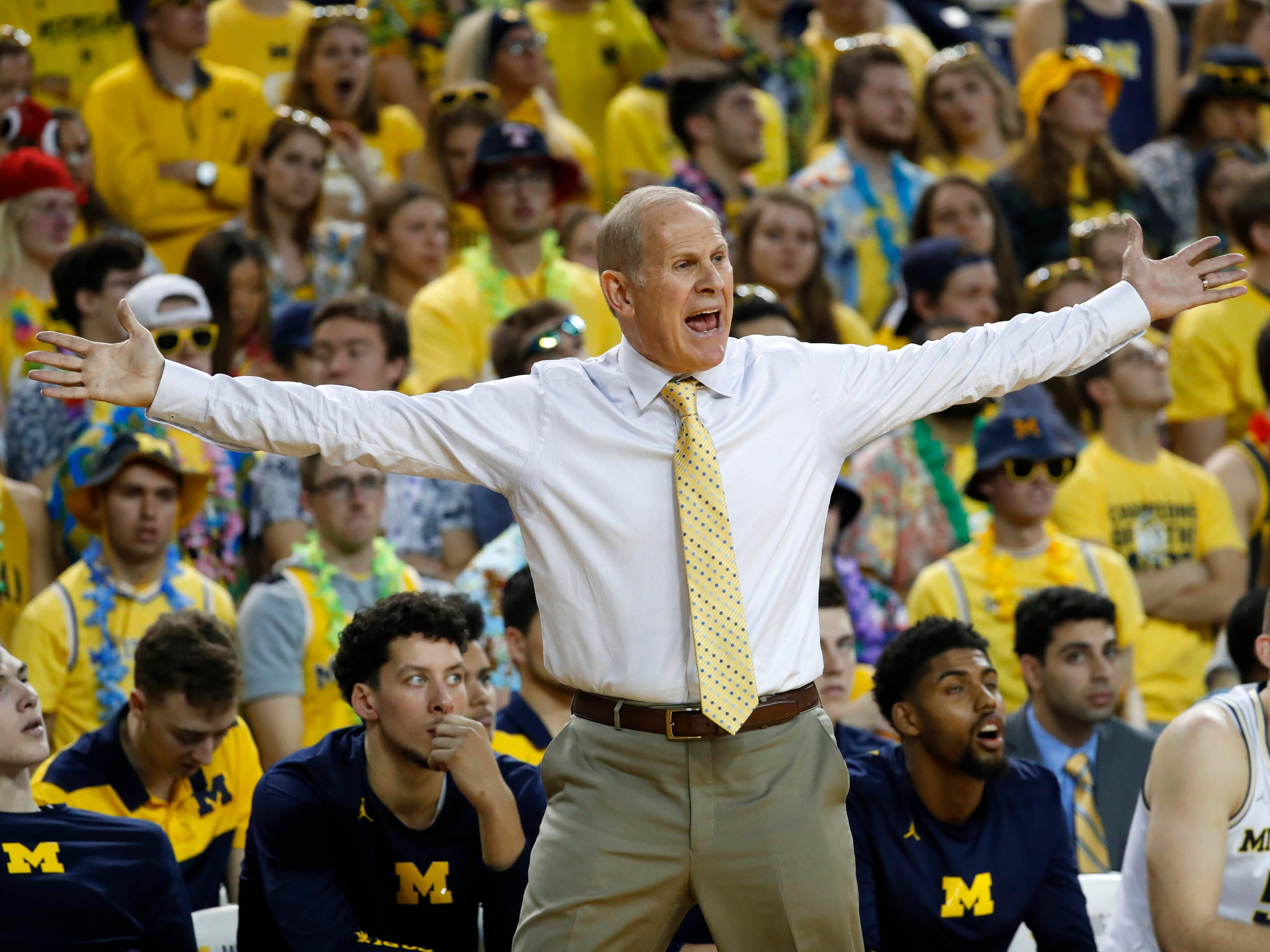 Michigan head coach John Beilein argues a call in the first half.