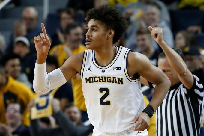 Michigan guard Jordan Poole, who scored a career-high 26 points, reacts to hitting a basket against South Carolina in the first half of the Wolverines' 89-78 victory in Ann Arbor, Mich., Saturday, Dec. 8, 2018.