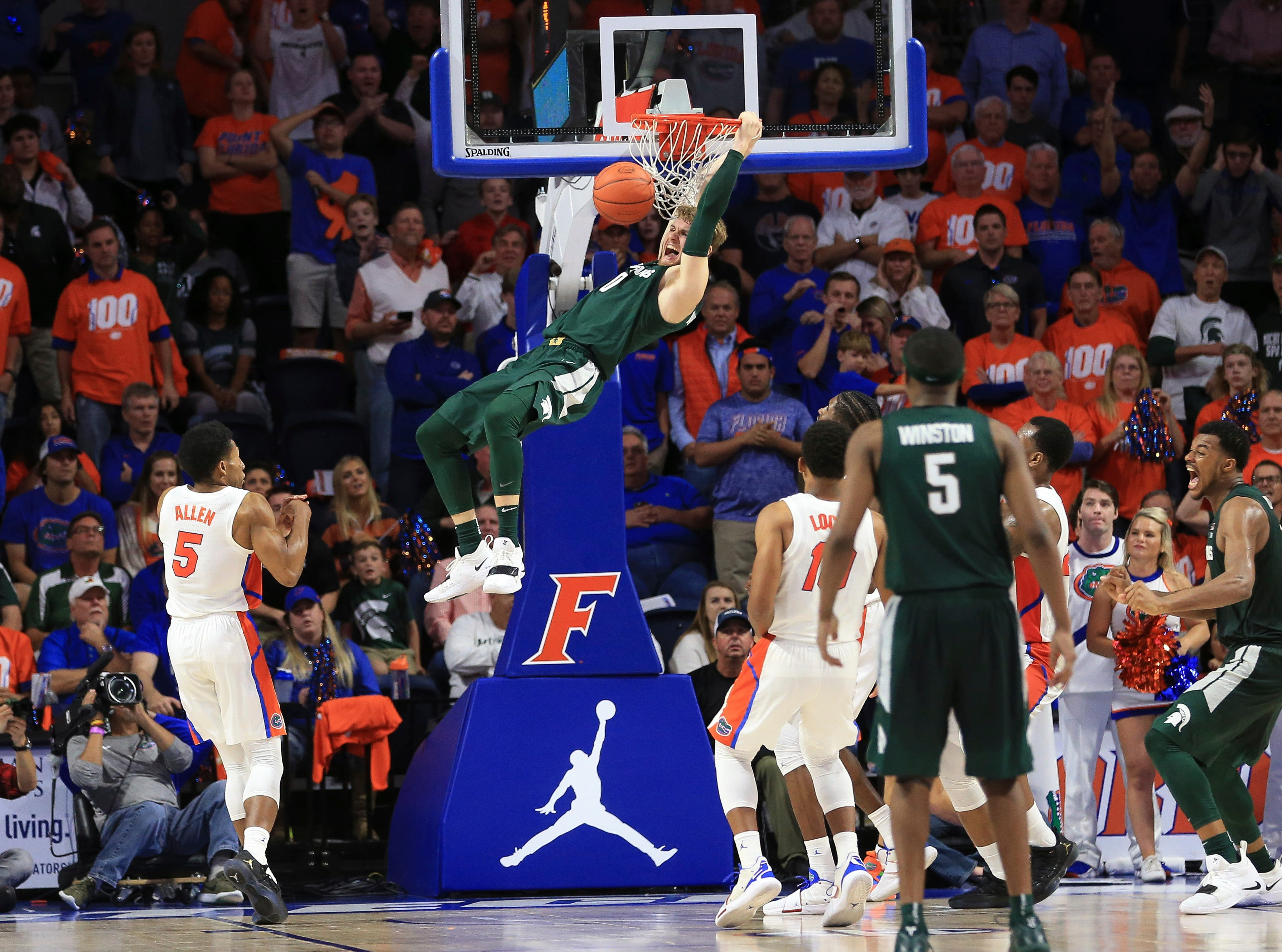 Michigan State forward Kyle Ahrens (0) dunks at the end of the second half.