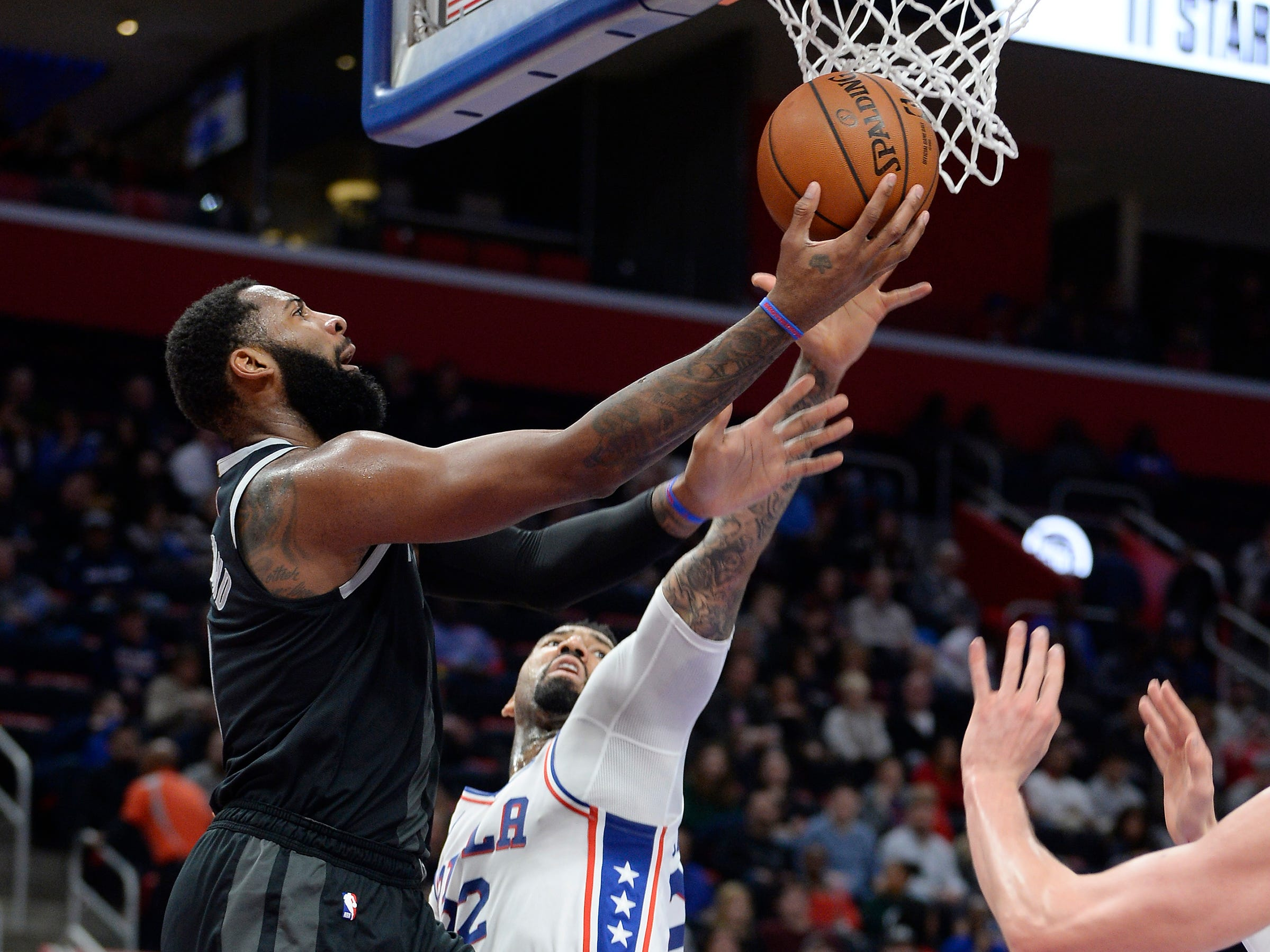 Pistons' Andre Drummond scores over 76ers' Wilson Chandler in the second quarter.