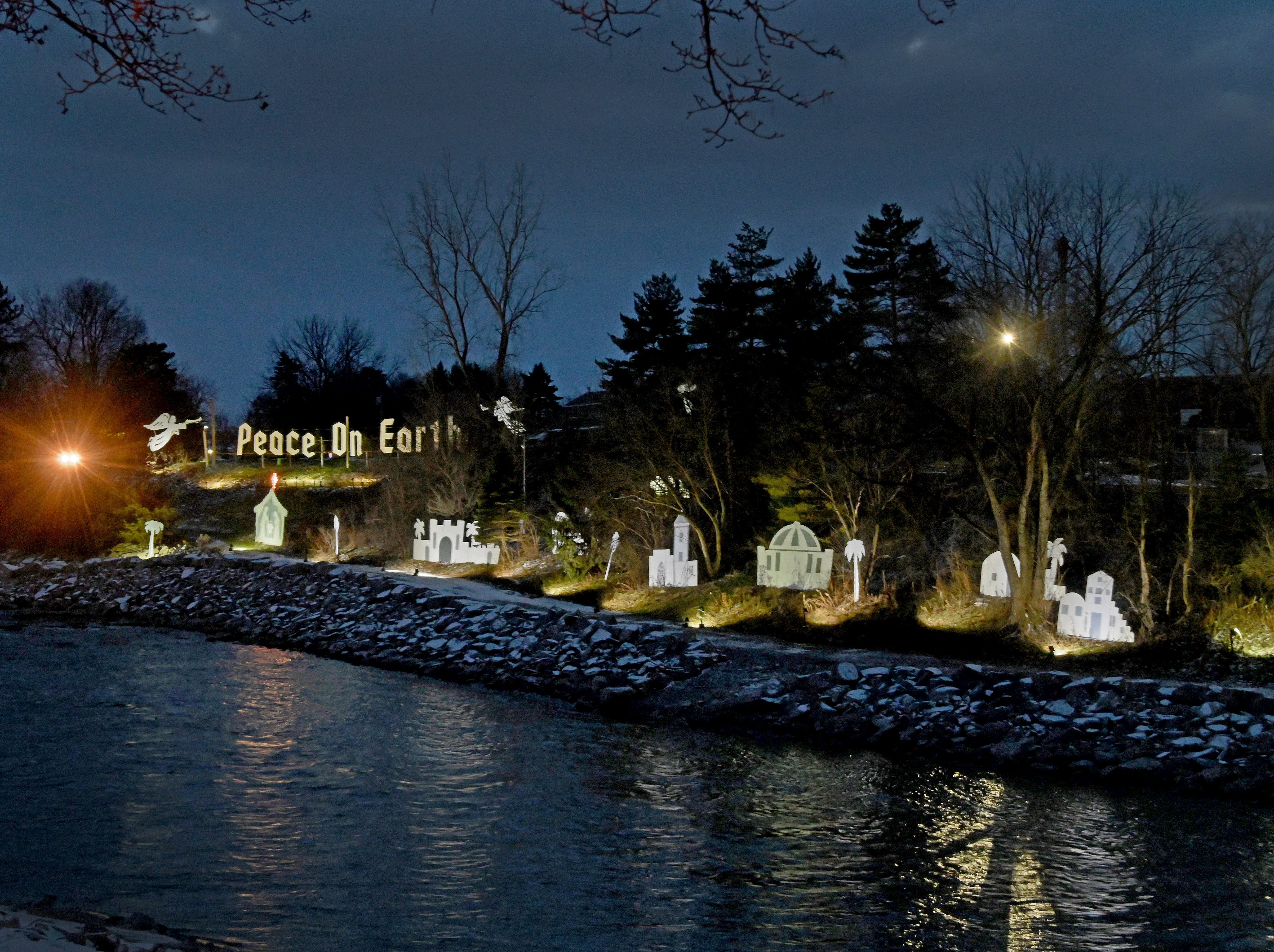 A Christmas display on the banks of the Cass River in Frankenmuth sends a message of peace.