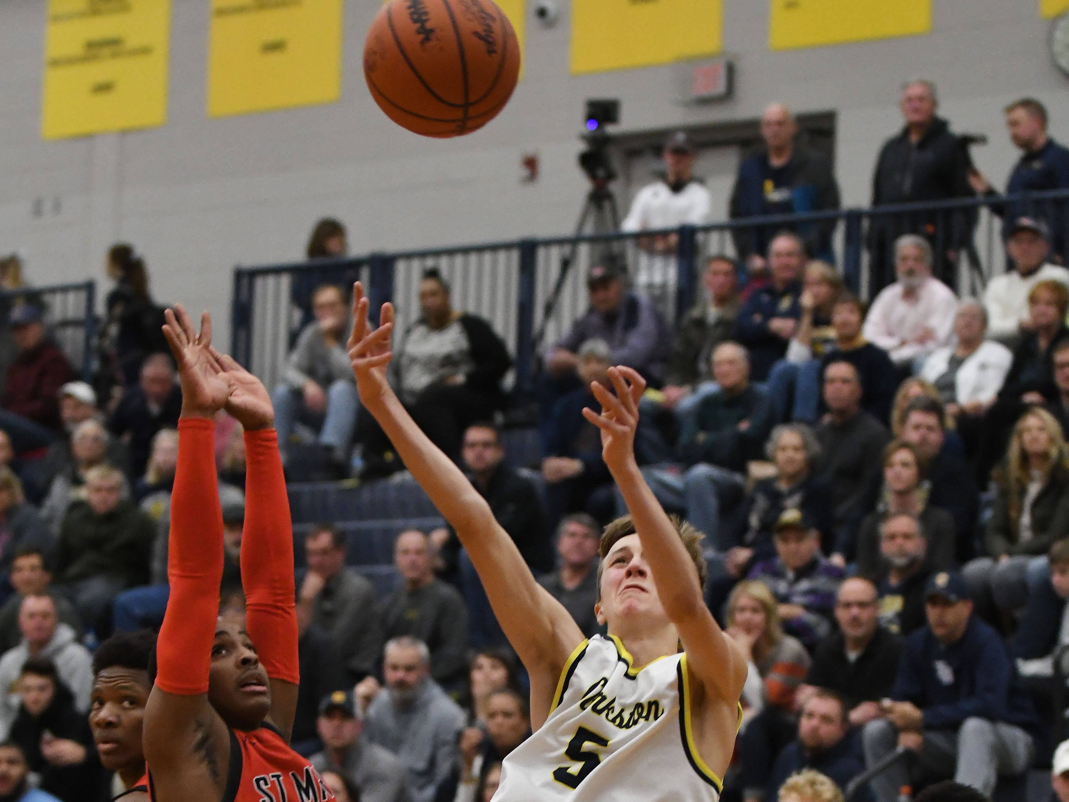 Clarkston's Desmond Mills-Bradley puts up a falling shot that goes in and one in the third quarter.