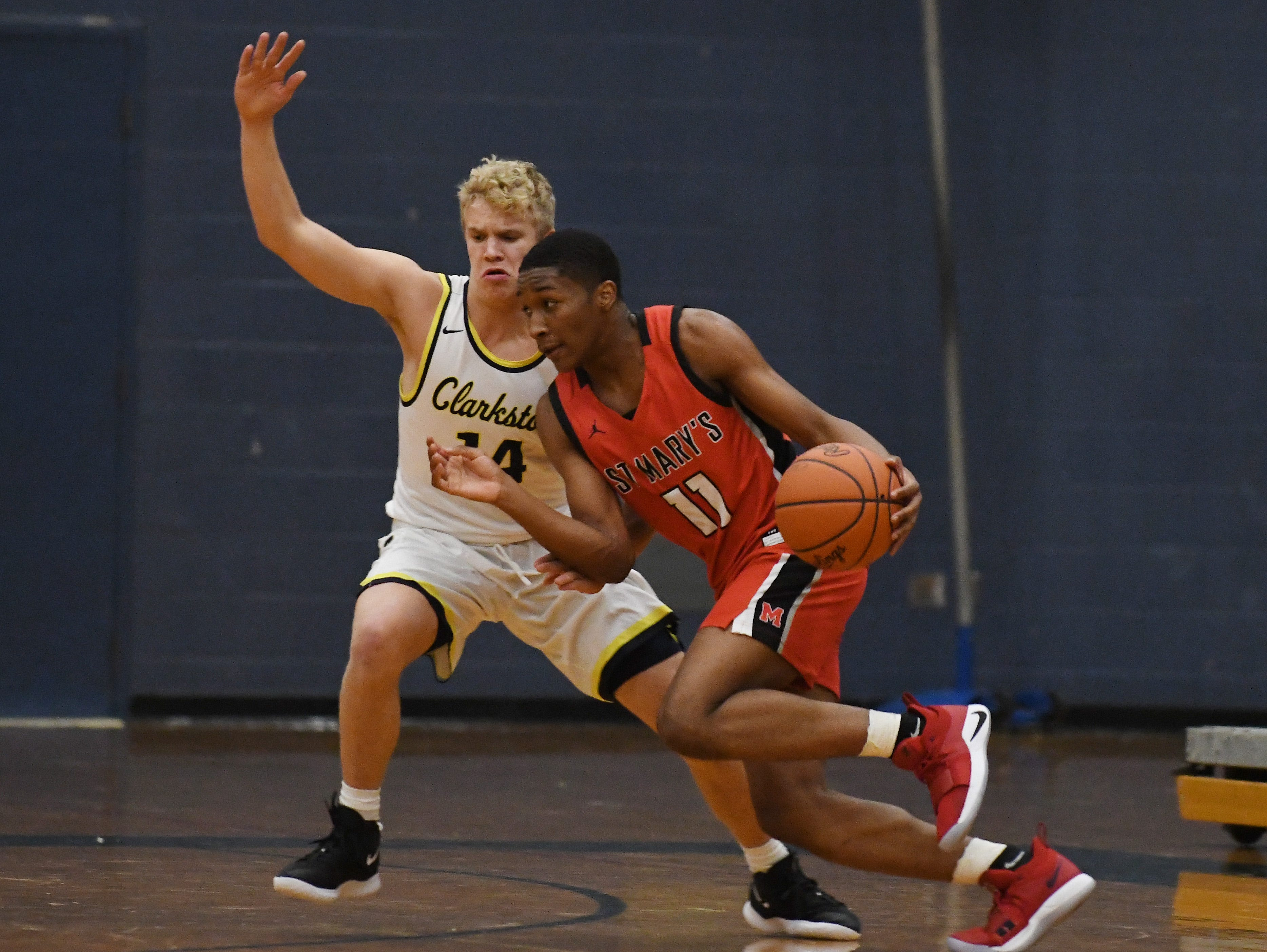 Clarkston's Jake Jensen defends against a driving St. Mary's Lorne Bowman II in the third quarter.