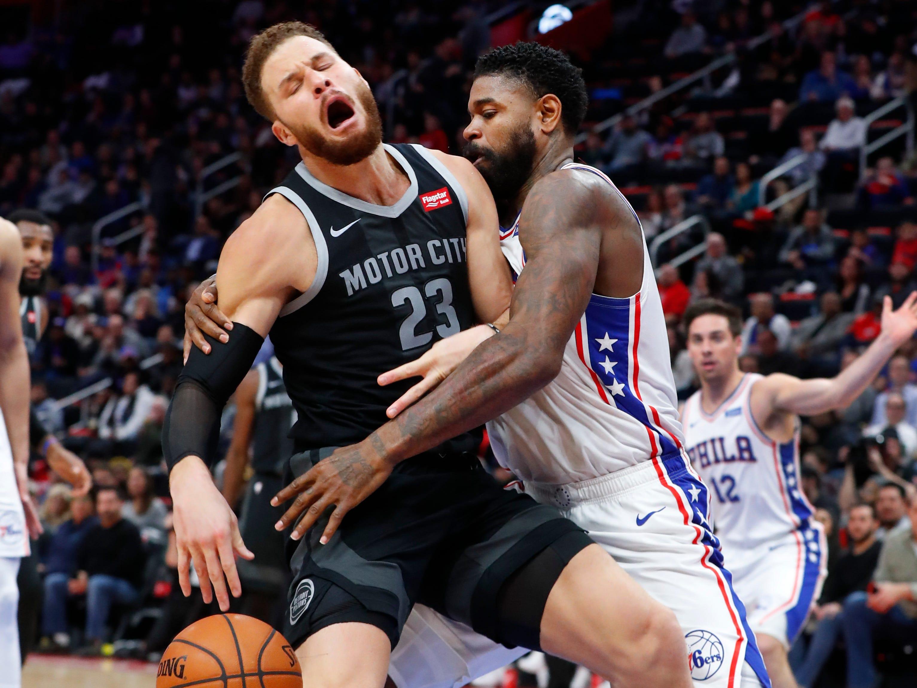 Philadelphia 76ers center Amir Johnson (5) fouls Detroit Pistons forward Blake Griffin (23) in the first half.