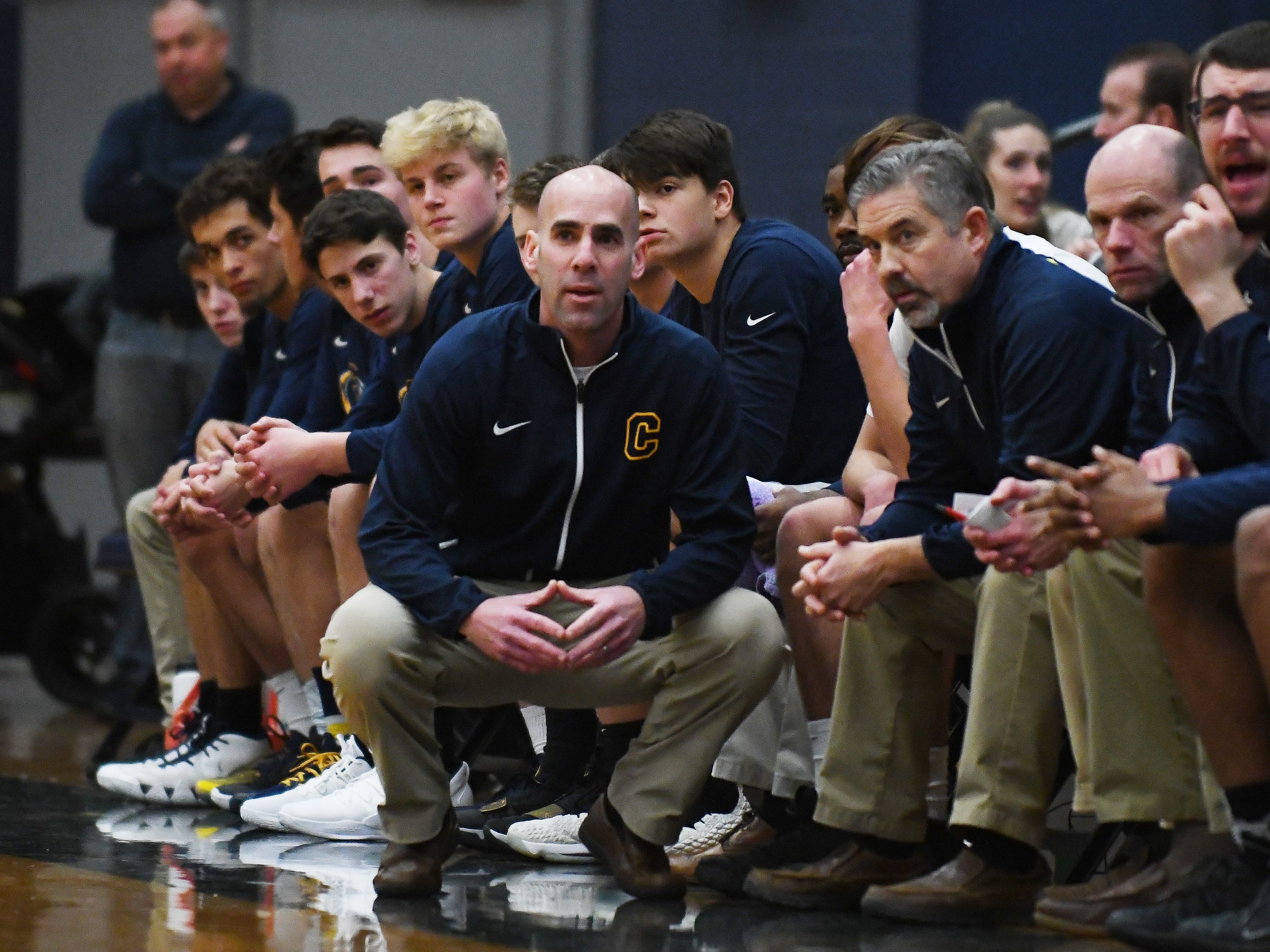 Clarkston's coach Tim Wasilk watches over his team in the first quarter.