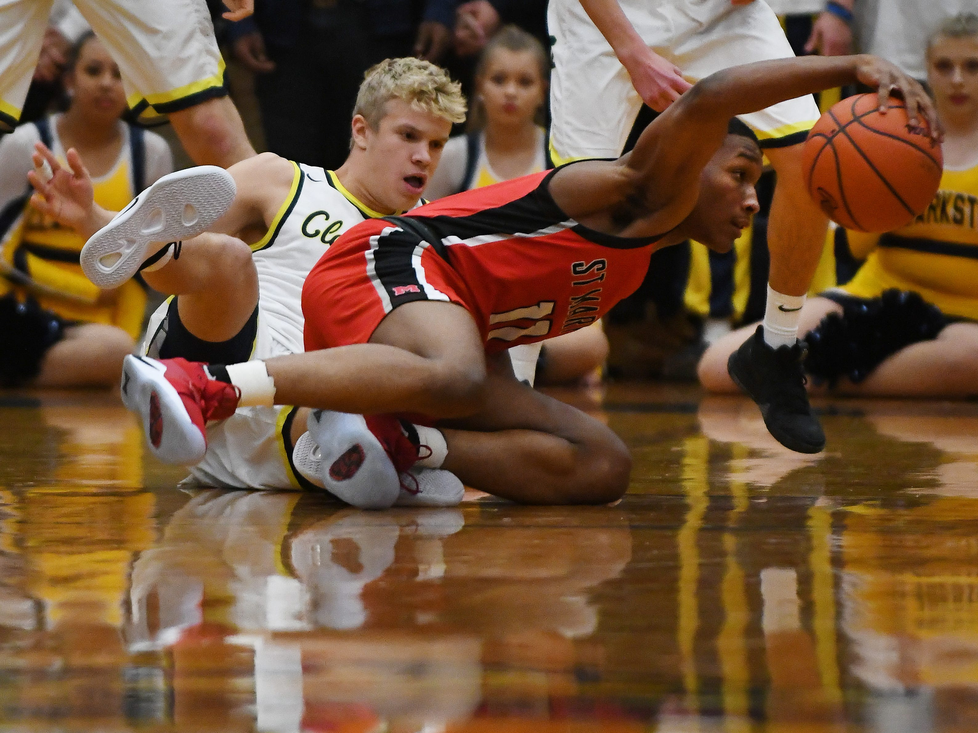 Clarkston's Jake Jensen and St. Mary's Lorne Bowman II battle for a loose ball in the first quarter.