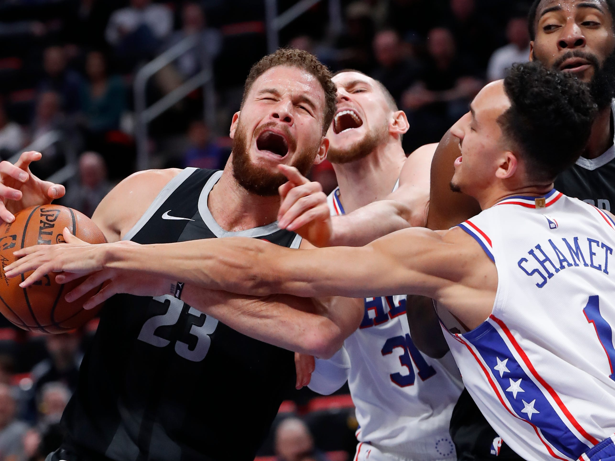 Detroit Pistons forward Blake Griffin (23) is fouled by Philadelphia 76ers forward Mike Muscala (31) as Landry Shamet (1) defends in the first half.