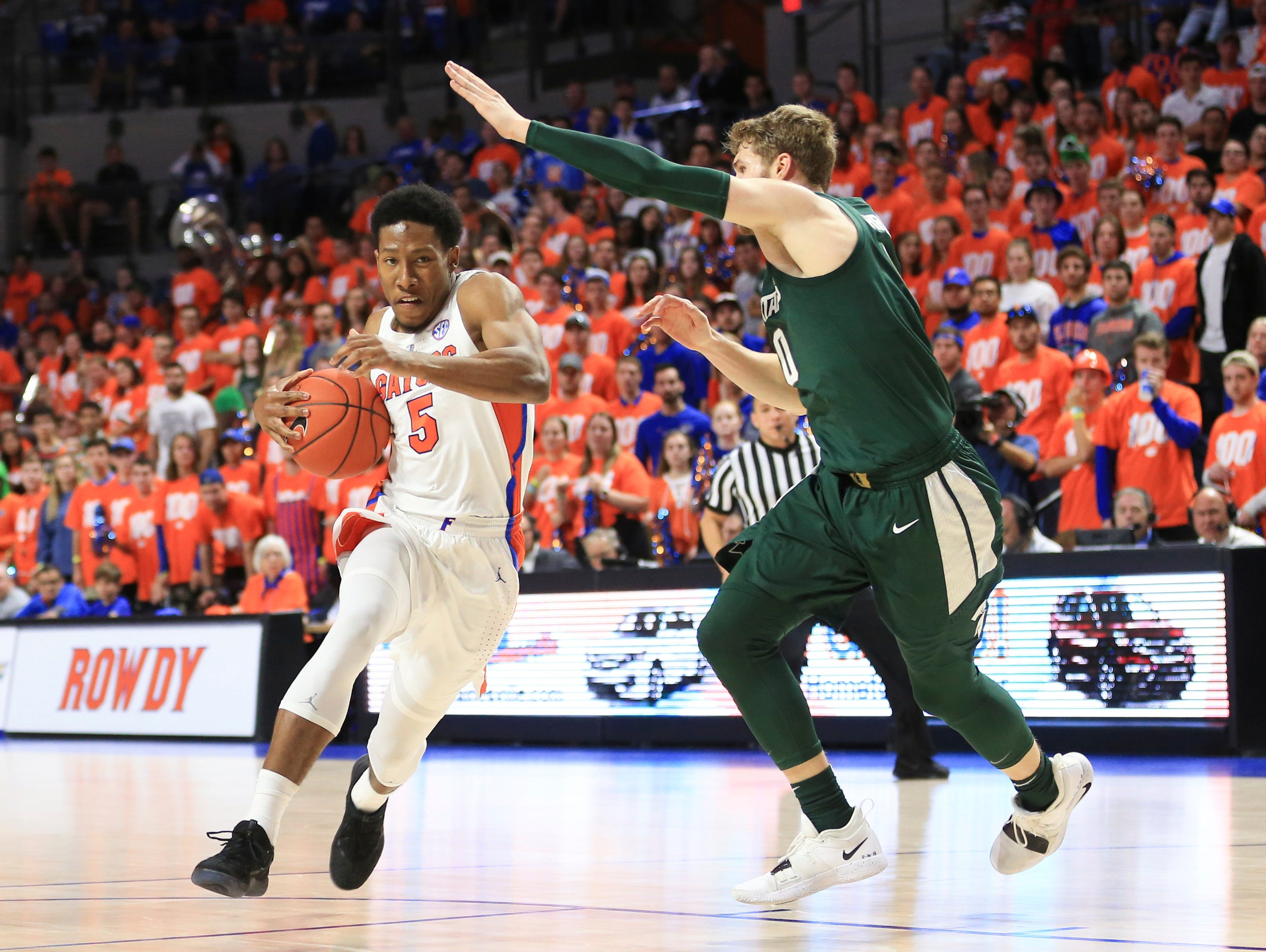 Florida guard KeVaughn Allen (5) drives to the basket past Michigan State forward Kyle Ahrens (0) during the second half.