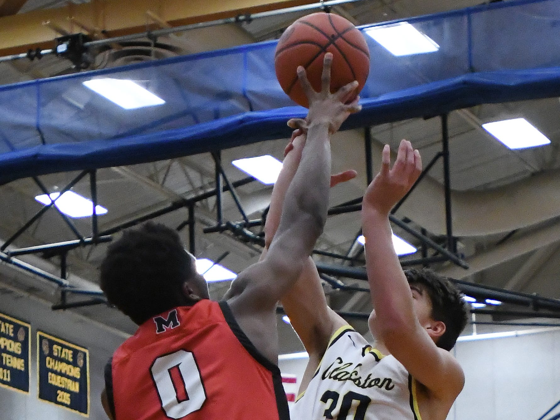 St. Mary's Peter Nwoke blocks a shot by Clarkston's Mike DePillo in the second quarter.