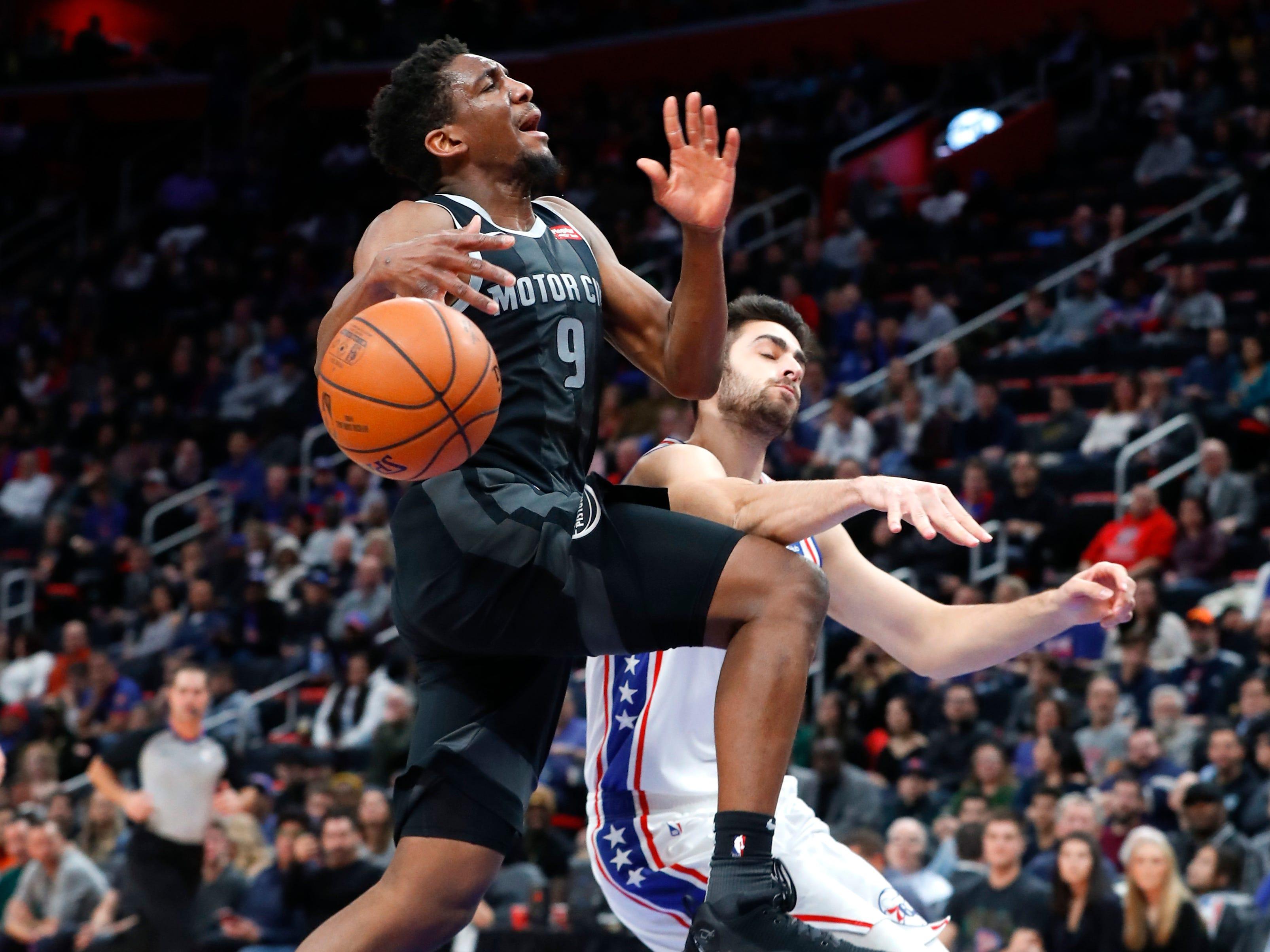 Philadelphia 76ers guard Furkan Korkmaz fouls Detroit Pistons guard Langston Galloway (9) in the first half.