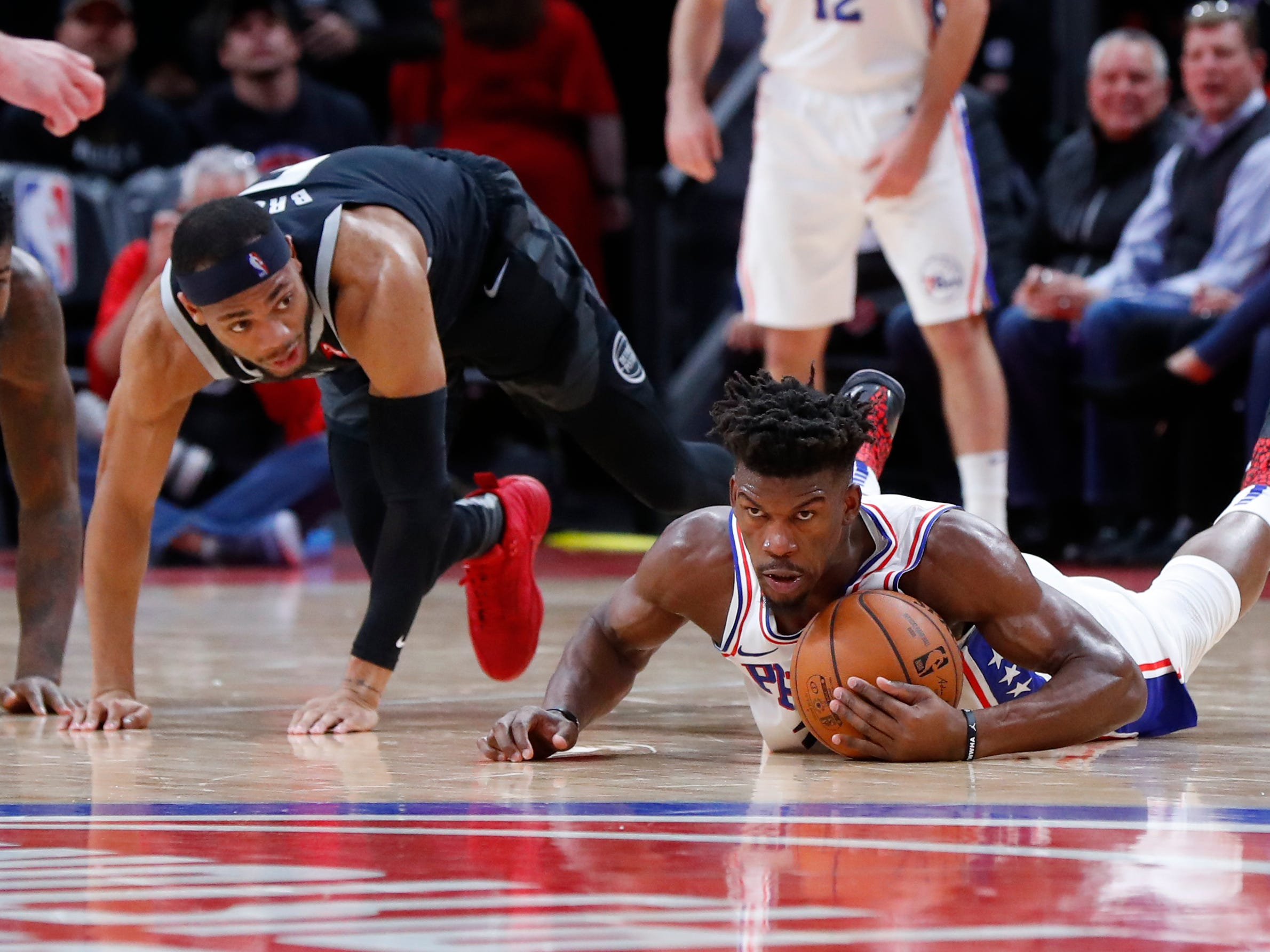 Philadelphia 76ers guard Jimmy Butler (23) collects the ball on the floor from Detroit Pistons guard Bruce Brown (6) in the first half.