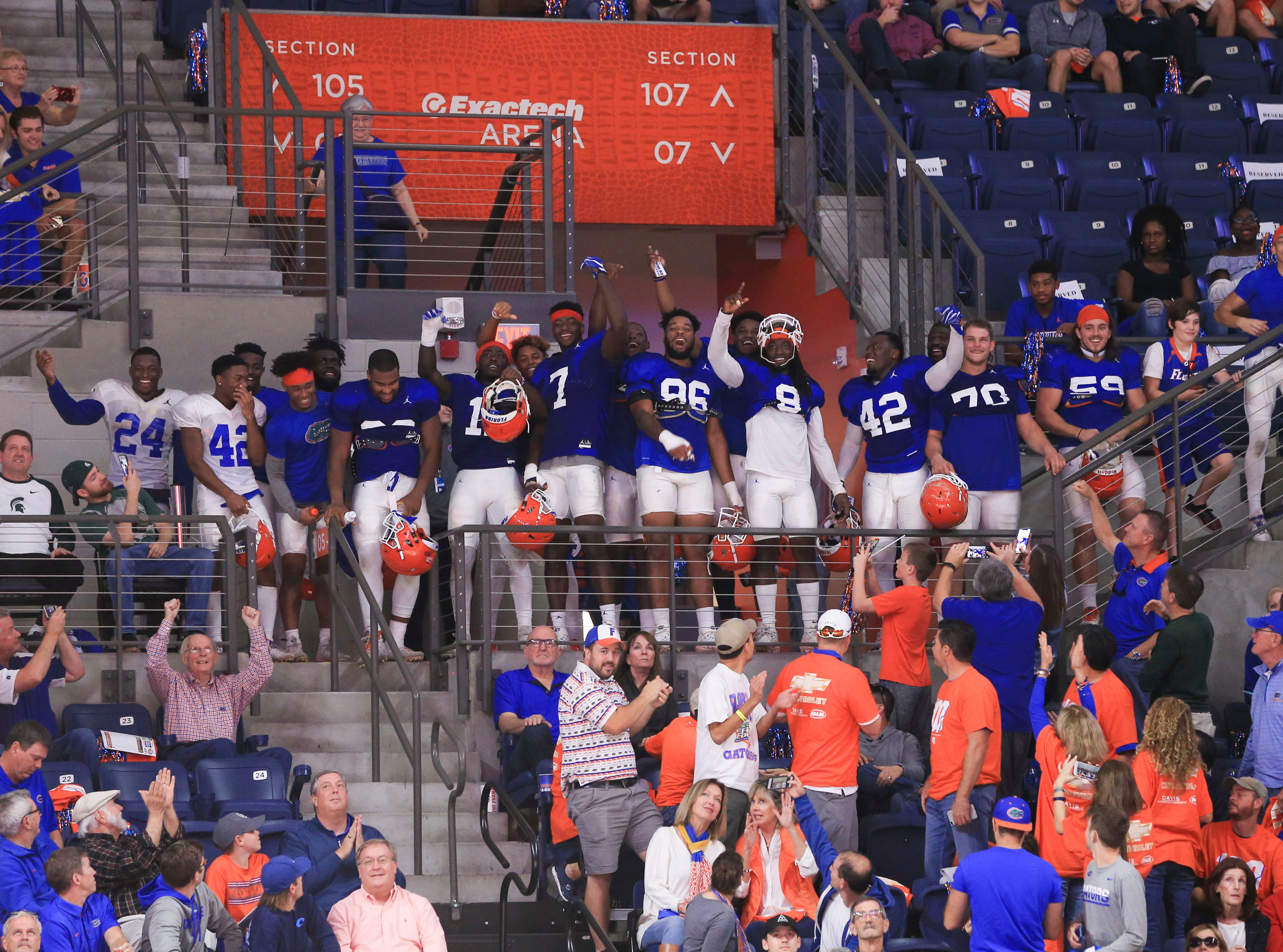 Members of the Florida football team watch the final minutes of the game against Michigan State during the second half.