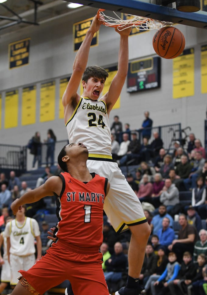 Clarkston's Matt Nicholson slams home a dunk over St. Mary's Khalil Rozier in the fourth quarter of the 62-46 Clarkston victory in Clarkston, Michigan on December 7, 2018.