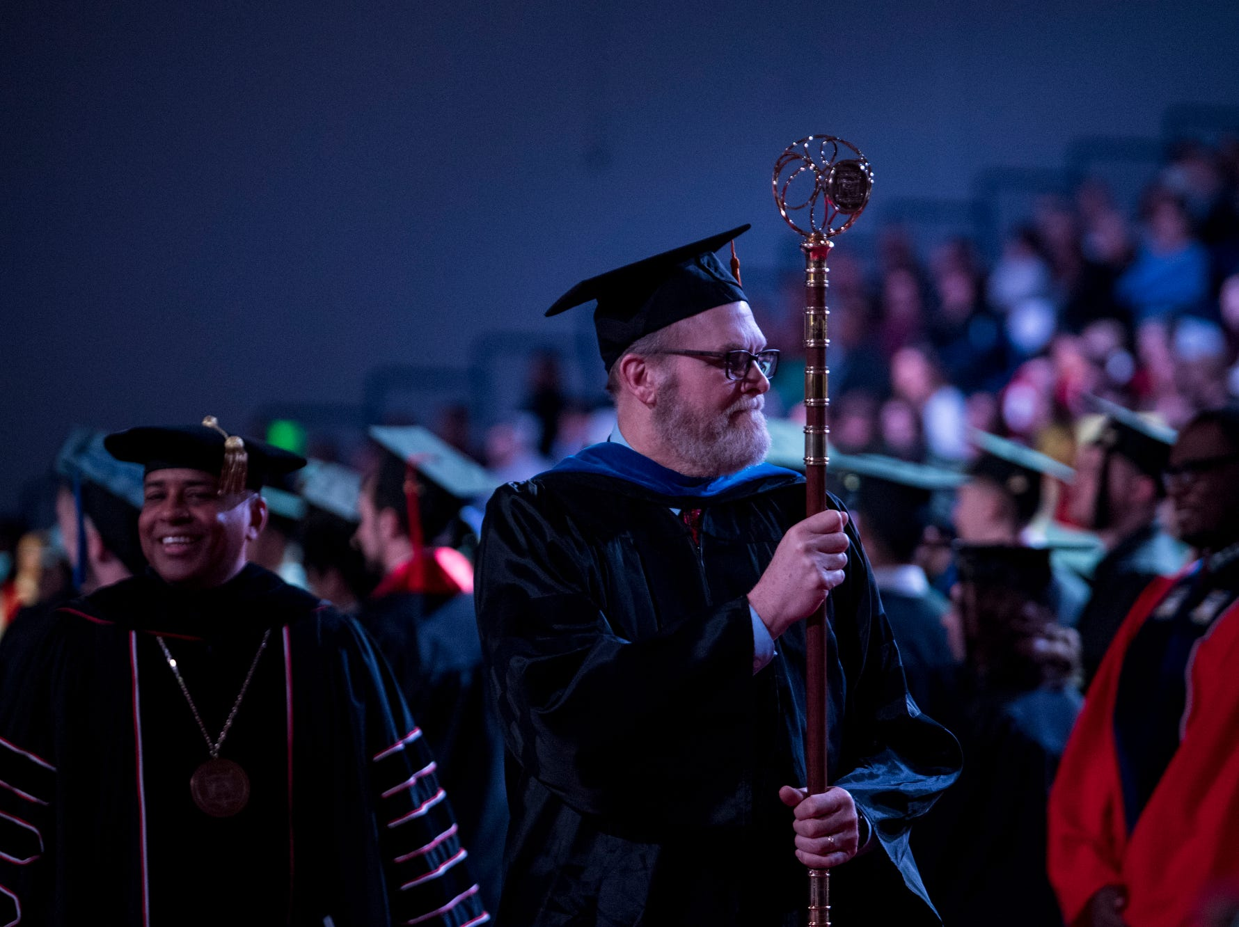 Grand Marshall Ernest H. Hall, Jr., Professor of Management, leads the recessional following the University of Southern Indiana's fall commencement ceremony for the College of Liberal Arts and the Romain College of Business at the school's Physical Activities Center in Evansville, Ind., Saturday, Dec. 8, 2018.