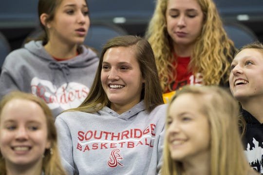 Myah Montgomery sits in the stand with friends as they watch the Southridge Raiders boys basketball team take on the Mater Dei Wildcats in the inaugural River City Showcase at the Ford Center Saturday, Dec. 8, 2018.