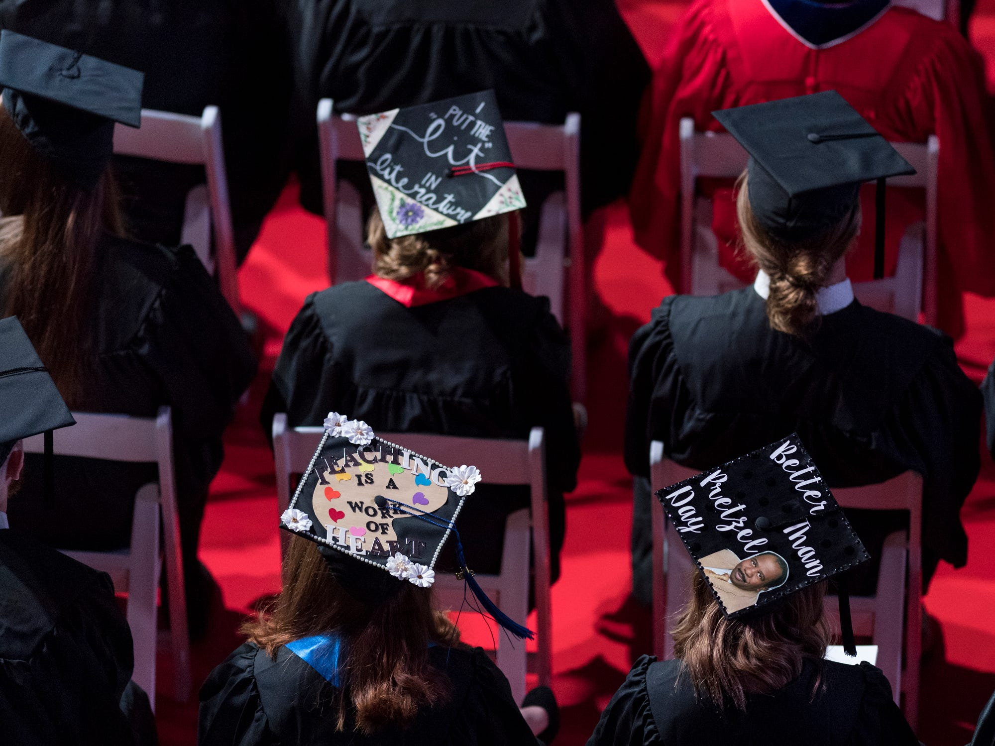 Graduates listen to the commencement address during the fall commencement ceremony for the University of Southern Indiana's College of Liberal Arts and the Romain College of Business inside the Physical Activities Center in Evansville, Ind., Saturday, Dec. 8, 2018.