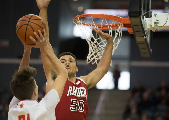 Southridge's Jaden Hayes (50) attempts the block Mater Dei's Sam Goebel (21) during the Mater Dei vs Southridge game of the inaugural River City Showcase at the Ford Center Saturday, Dec. 8, 2018.