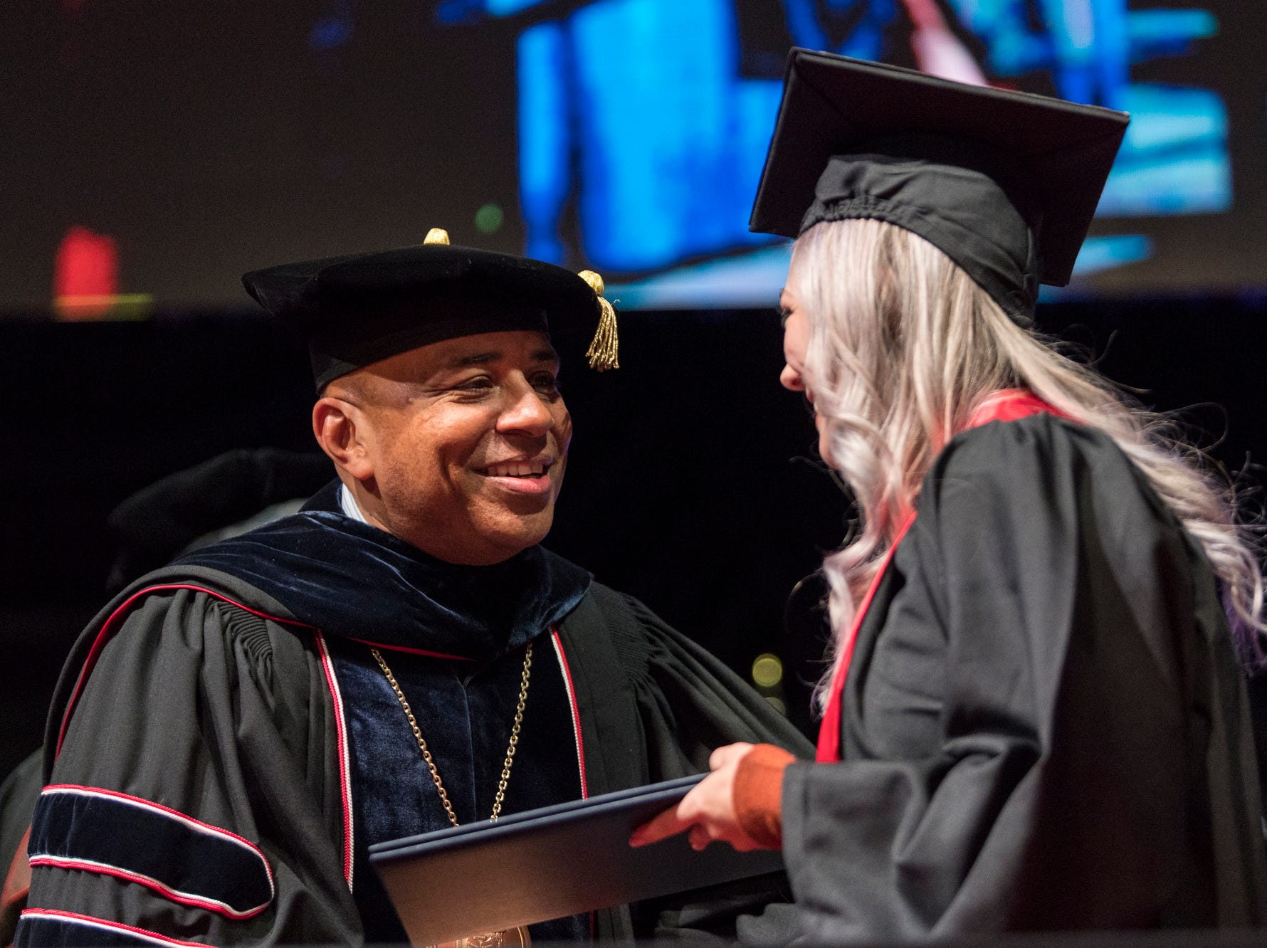 President Ronald S. Rochon, left, presents Samantha Christen Enders of Noblesville, Ind., with her Bachelor of Science degree during the University of Southern Indiana's fall commencement ceremony for the College of Liberal Arts and the Romain College of Business inside the school's Physical Activities Center in Evansville, Ind., Saturday, Dec. 8, 2018.