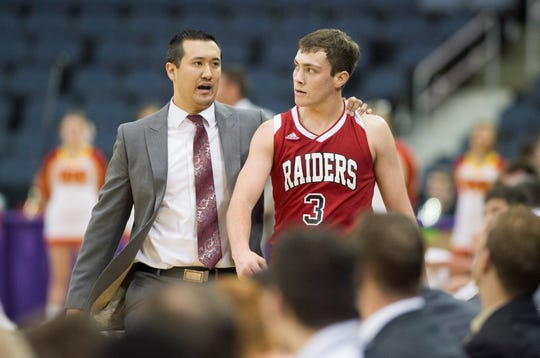 Southridge boys basketball head coach Mark Rohrer talks with Matthew Price (3) on the sideline against Mater Dei during the River City Showcase at Ford Center in December.