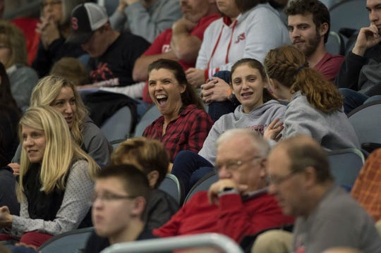 The Montgomery family sits in the stands as they watch the Southridge Raiders boys basketball team take on the Mater Dei Wildcats in the inaugural River City Showcase at the Ford Center Saturday, Dec. 8, 2018.