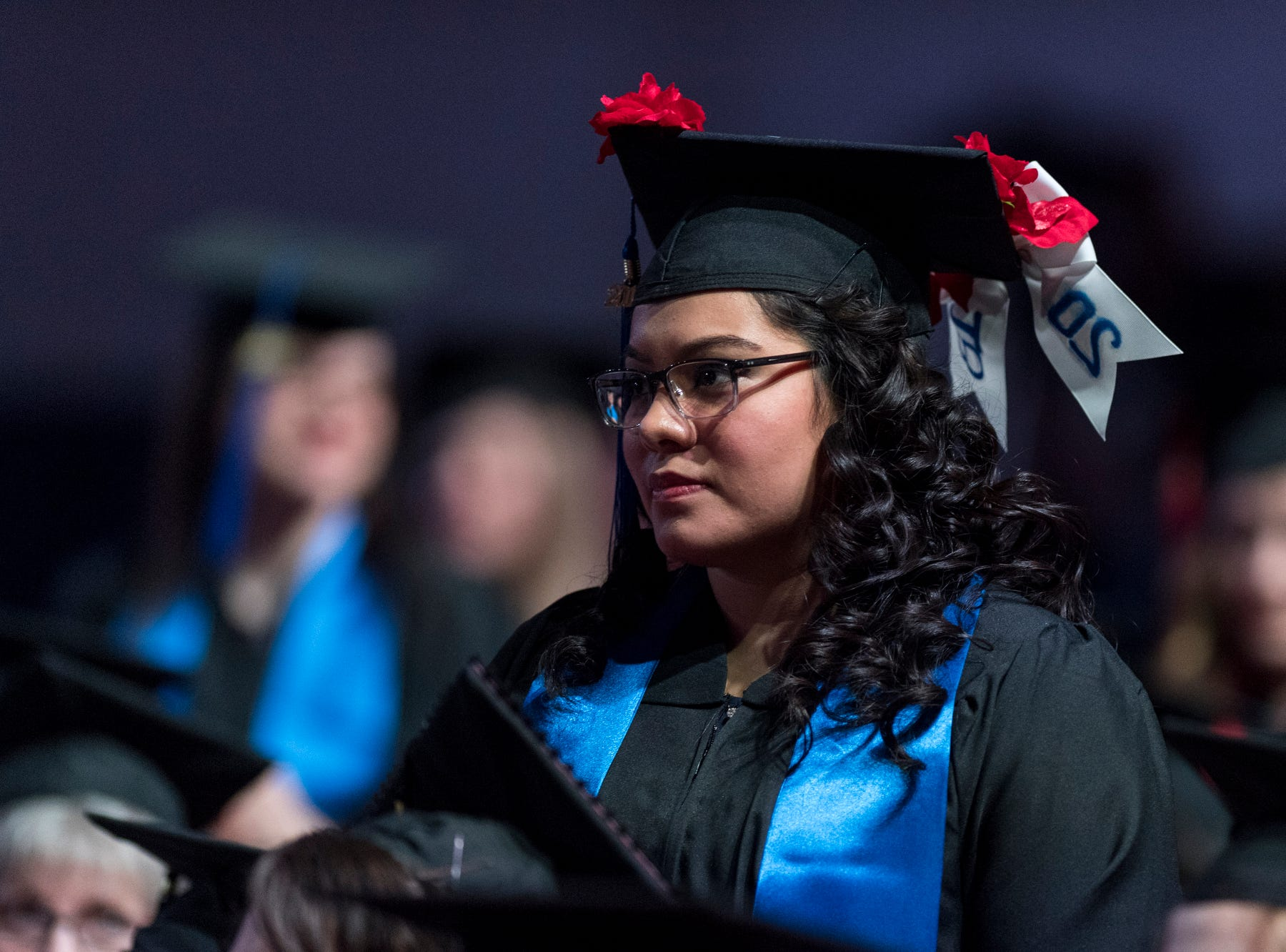 Rosalinda Ornelas of Huntingburg, Ind., stands to be recognized for graduating cum laude honors during the fall commencement ceremony for the University of Southern Indiana's College of Liberal Arts and the Romain College of Business inside the school's Physical Activities Center in Evansville, Ind., Saturday, Dec. 8, 2018.