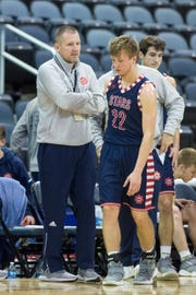 Bedford North Lawrence assistant coach Damon Bailey and son Bedford's Brayton Bailey (22) during the Castle vs Bedford North Lawrence game at the Ford Center Saturday, Dec. 8, 2018.