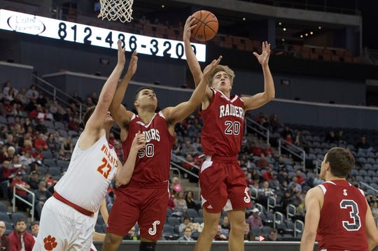 Southridge's Joe Lagrange (20) grabs a rebound during the Mater Dei vs Southridge game of the inaugural River City Showcase at the Ford Center Saturday, Dec. 8, 2018.