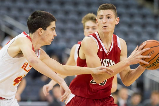 Southridge's Colson Montgomery (23) looks to pass the ball during the Mater Dei vs Southridge game of the inaugural River City Showcase at the Ford Center Saturday, Dec. 8, 2018.