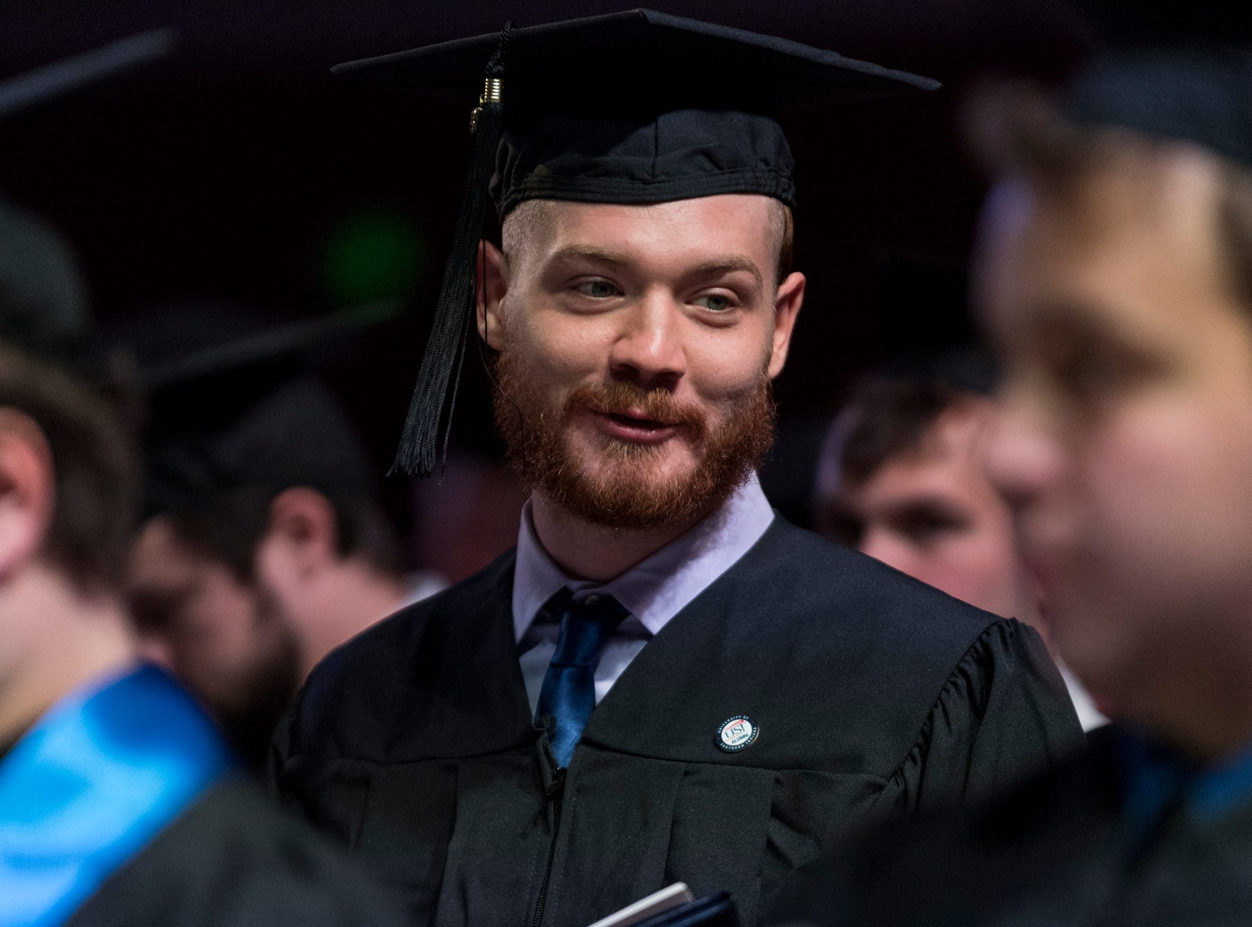 """Graduate Chase Hoehn of Mount Vernon sings the University of Southern Indiana's Alma Mater song """"Constant, Faithful, and True"""" during the fall commencement ceremony for the University of Southern Indiana's College of Liberal Arts and the Romain College of Business inside the school's Physical Activities Center in Evansville, Ind., Saturday, Dec. 8, 2018."""