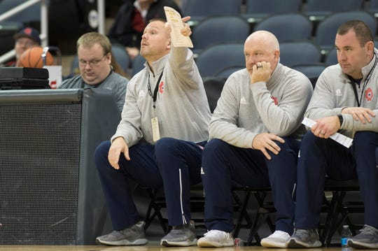 Bedford North Lawrence assistant coach Damon Bailey, left, during the Castle vs Bedford North Lawrence game at the Ford Center Saturday, Dec. 8, 2018. Bailey is Indiana's all-time high school leading scorer. He graduated from Bedford North Lawrence in 1990 before playing for Bob Knight at IU.