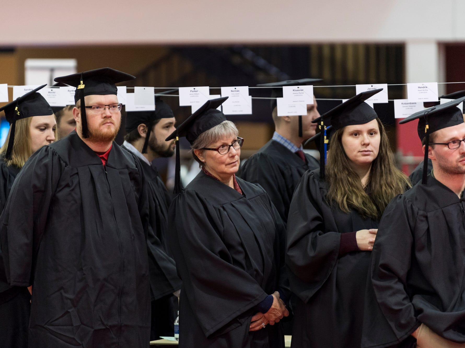 Graduates line up in the Recreation, Fitness, and Wellness Center before walking over to the Physical Activities Center to begin the University of Southern Indiana's fall commencement ceremony for the College of Liberal Arts and the Romain College of Business, Saturday afternoon, Dec. 8, 2018.