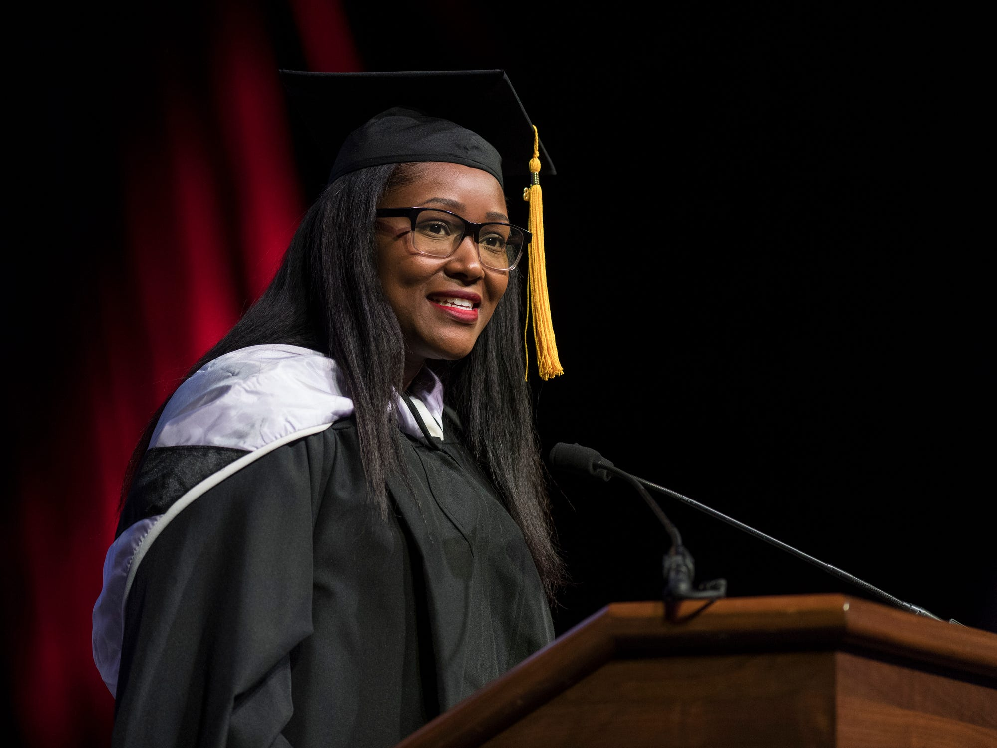 Xavia Harrington-Chate, Instructor of English, gives the commencement address during the University of Southern Indiana's fall commencement ceremony for the College of Liberal Arts and Romain College of Business at the Physical Activities Center on campus in Evansville, Ind., Saturday, Dec. 8, 2018. She is the 2018 recipient of the H. Lee Cooper Core Curriculum Teaching award.