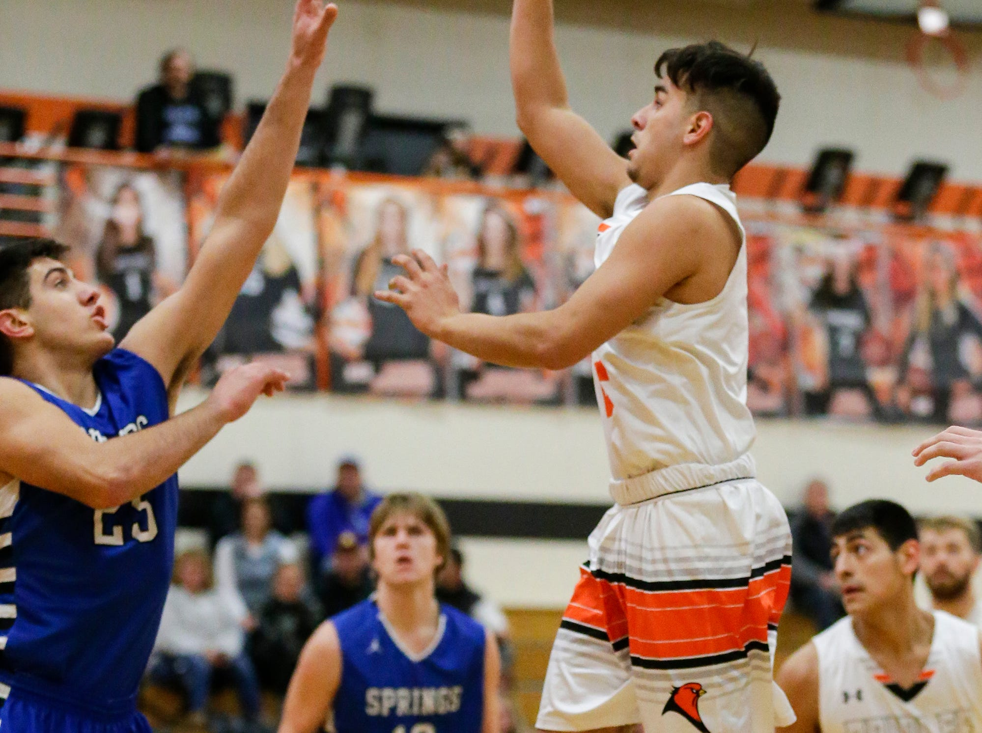 North Fond du Lac High School boys basketball's Matthew Holbus goes up for a basket against St. Mary's Springs Academy's Justin Ditter during their game Friday, December 7, 2018 in North Fond du Lac, Wisconsin. Doug Raflik/USA TODAY NETWORK-Wisconsin