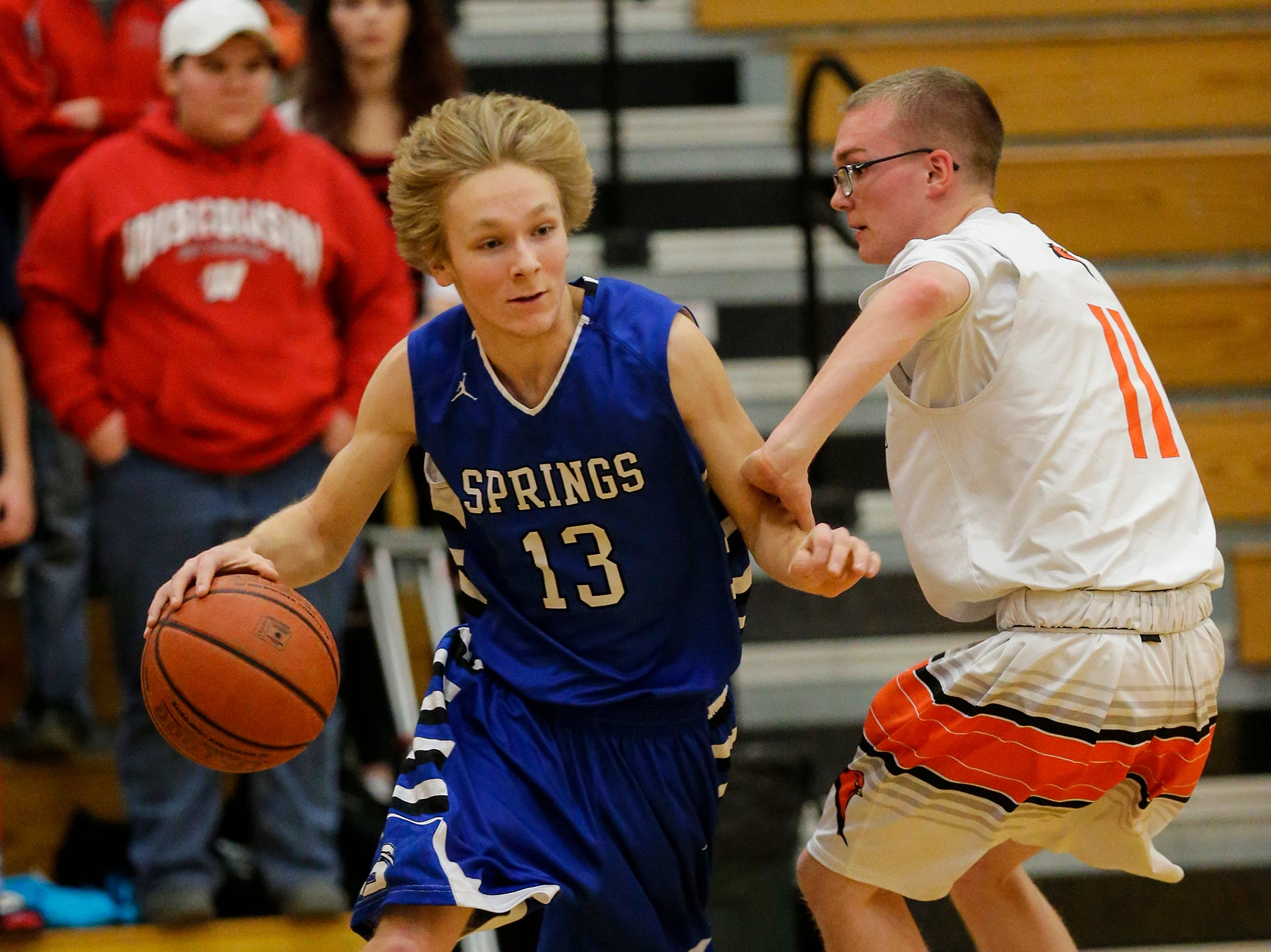 St. Mary's Springs Academy's boys basketball's Myles Ottery works his way past North Fond du Lac High School's Dillon Holbus during their game Friday, December 7, 2018 in North Fond du Lac, Wisconsin. Doug Raflik/USA TODAY NETWORK-Wisconsin