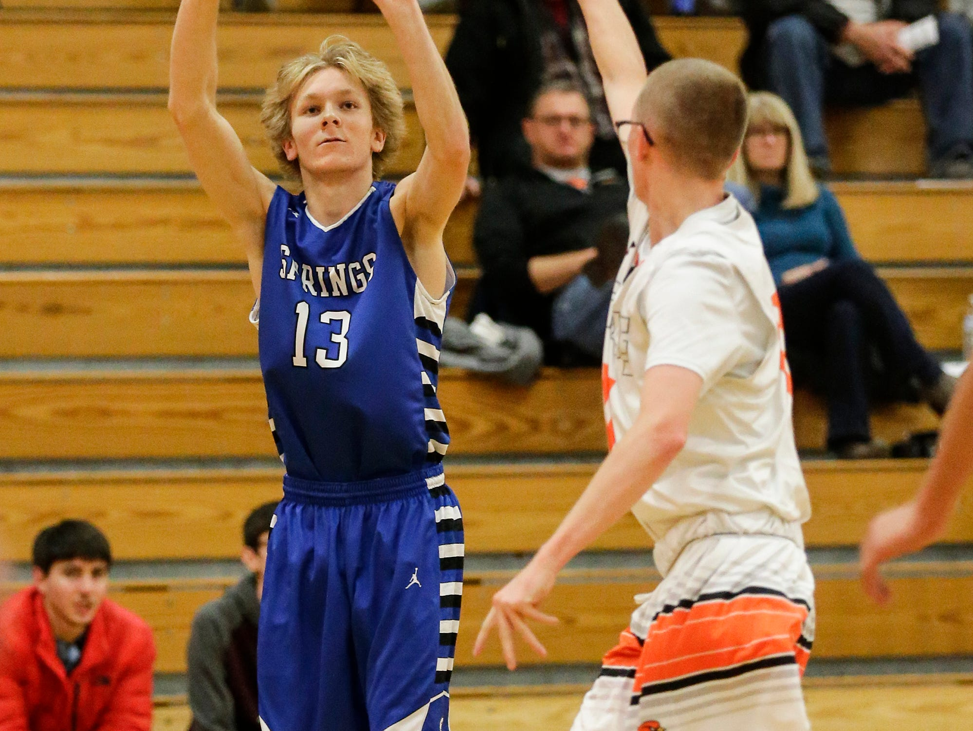 St. Mary's Springs Academy's boys basketball's Myles Ottery makes this three pointer over North Fond du Lac High School's Dillon Holbus during their game Friday, December 7, 2018 in North Fond du Lac, Wisconsin. Doug Raflik/USA TODAY NETWORK-Wisconsin
