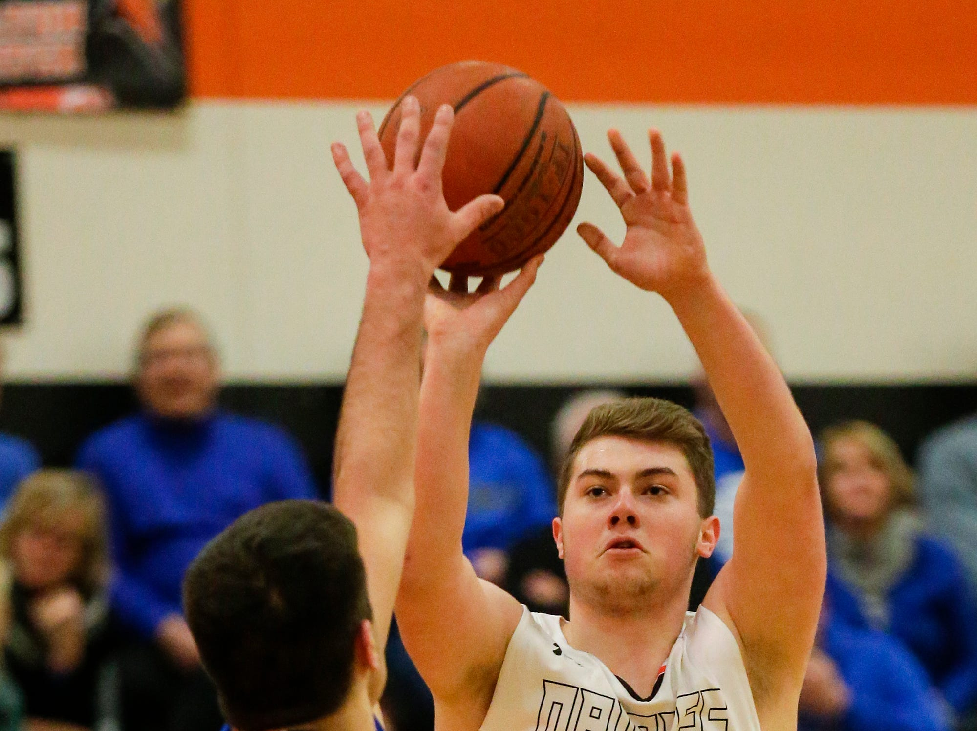North Fond du Lac High School boys basketball's Mathias Gilbertson shoots a basket over St. Mary's Springs Academy's Justin Ditter during their game Friday, December 7, 2018 in North Fond du Lac, Wisconsin. Doug Raflik/USA TODAY NETWORK-Wisconsin