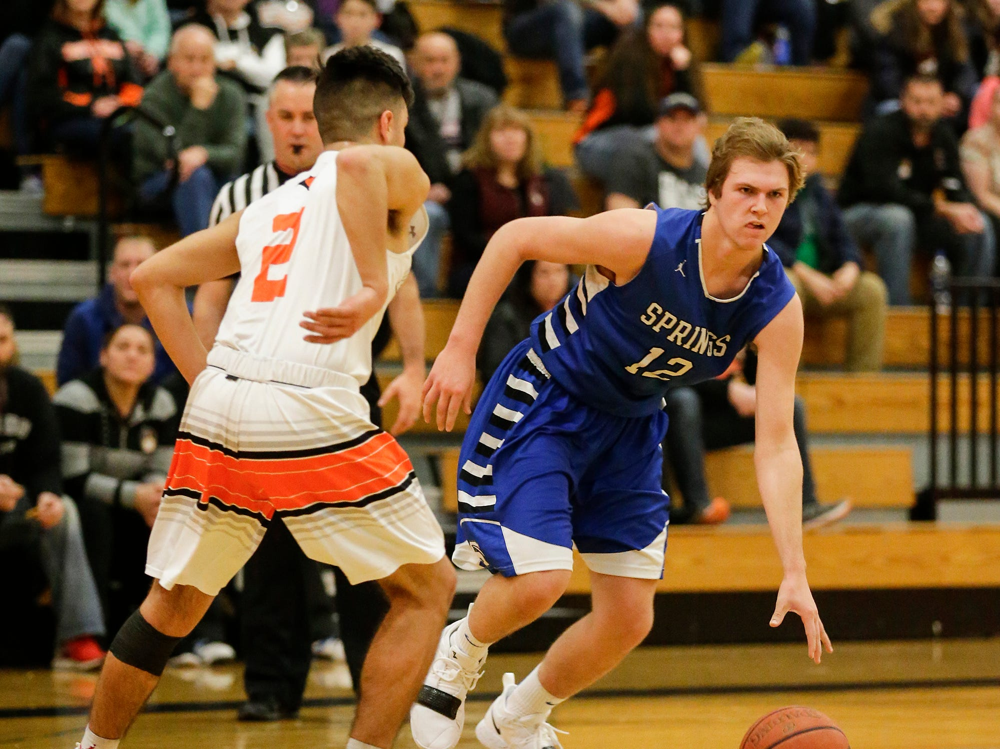 St. Mary's Springs Academy's boys basketball's Aiden Ottery dribbles the ball past North Fond du Lac High School's Tony Reyes during their game Friday, December 7, 2018 in North Fond du Lac, Wisconsin.