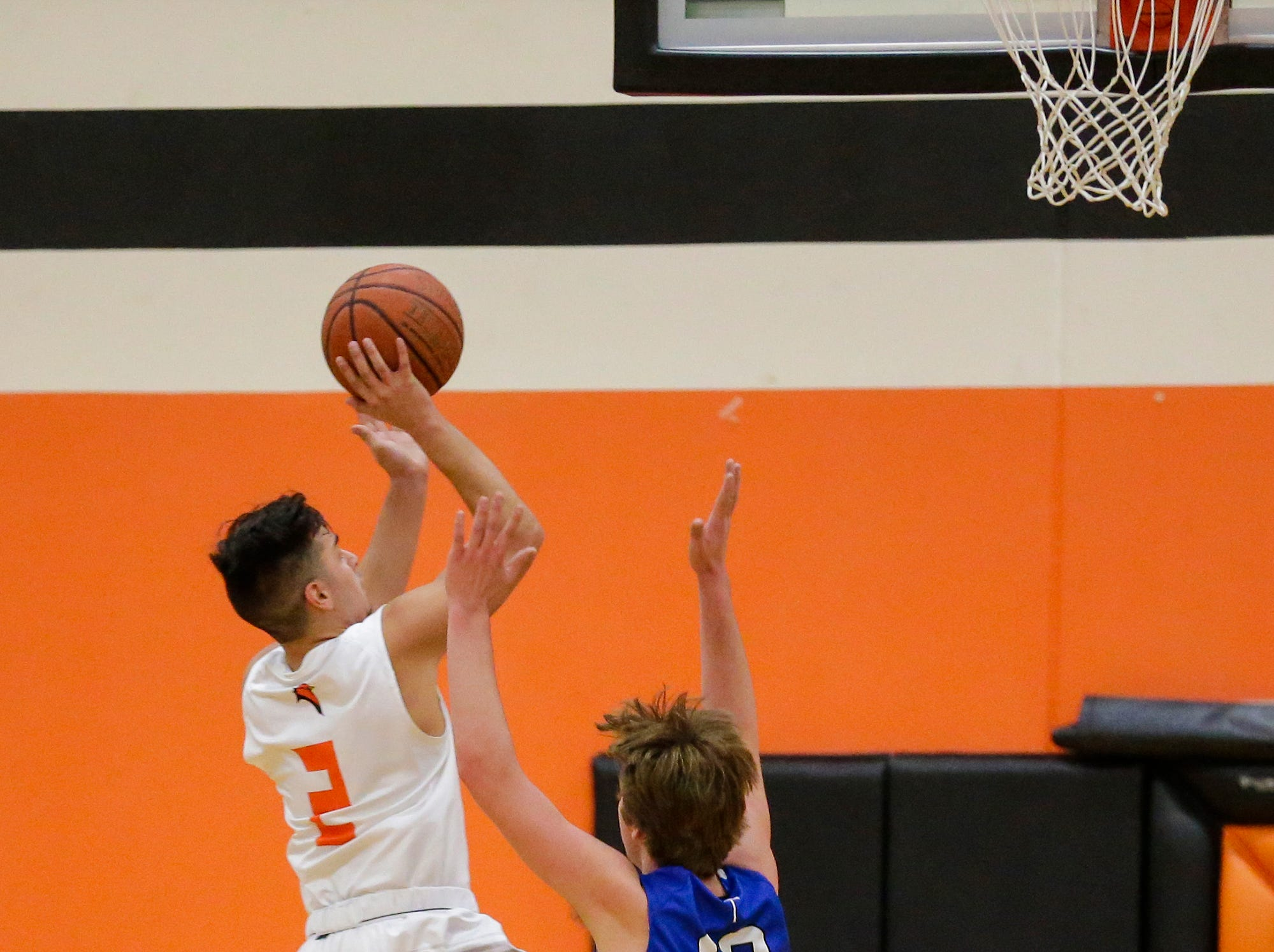 North Fond du Lac High School boys basketball's Tony Reyes goes up for a basket against St. Mary's Springs Academy's Aiden Ottery during their game Friday, December 7, 2018 in North Fond du Lac, Wisconsin. Doug Raflik/USA TODAY NETWORK-Wisconsin